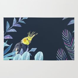 Cockatiel with tropical leaves and dark blue background Rug