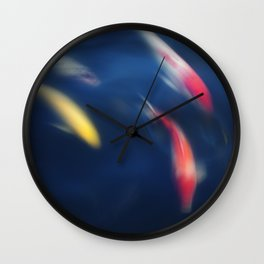 Koi fish in a pond Wall Clock