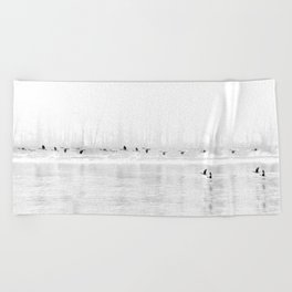 Canadian Geese flying formation  over the river through the fog Beach Towel