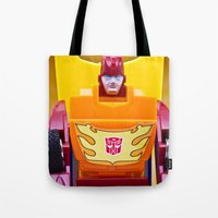 transformer Tote Bags featuring G1 Transformers Autobot Rodimus Prime by TJAguilar Photos