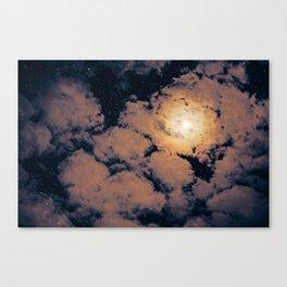 Full moon through purple clouds Canvas Print