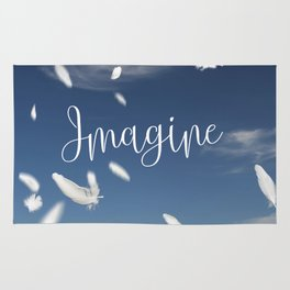 Imagine- Feathers and Typography on blue summersky Rug