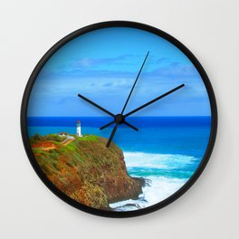lighthouse on the green mountain with blue ocean and blue sky view at Kauai, Hawaii, USA Wall Clock