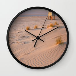 Refuge hut on Terschelling island in The Netherlands at sunset Wall Clock