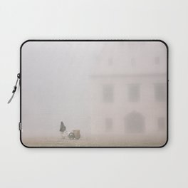 man pulling a cart on the square of Bardejov Laptop Sleeve