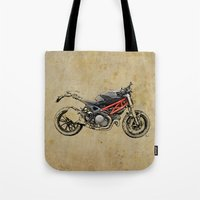 ducati Tote Bags featuring Ducati Monster 796 by Larsson Stevensem