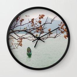 row a boat Wall Clock