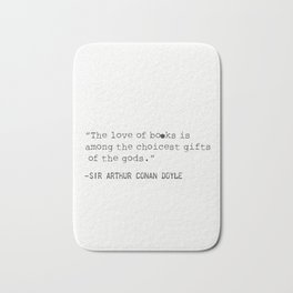 """The love of books is among the choicest gifts of the gods.""   Sir Arthur Conan Doyle Bath Mat"