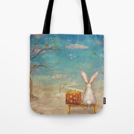 Sad rabbit  with suitcase sitting on the bench on the cloud in sky  Tote Bag