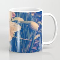 rileigh smirl Mugs featuring Daffodil by Rileigh Smirl