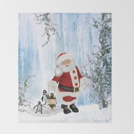 Santa Claus with funny penguin Throw Blanket