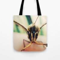 moth Tote Bags featuring moth by Sookie Endo