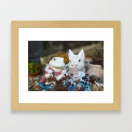 The bunny and the frog Framed Art Print