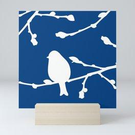 bird on twig blue and white Mini Art Print