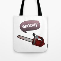 evil dead Tote Bags featuring Evil dead Groovy chainsaw by Komrod