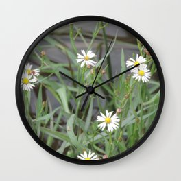 flowers on the river bank Wall Clock