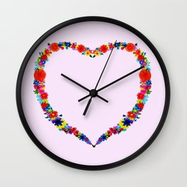 heart made of flowers on a pink background . Artwork Wall Clock