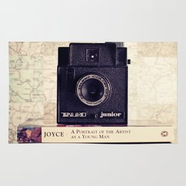 Vintage black camera and Joyce and Dracula books on Map pattern background  Rug