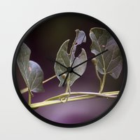 eat Wall Clocks featuring Eat by CrookedHeart