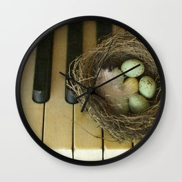 Chocolate Eggs in a Birds Nest on a Vintage Piano. Wall Clock
