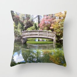 Small Wood Bridge Over Pond In Japanese Garden Throw Pillow