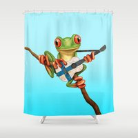 finland Shower Curtains featuring Tree Frog Playing Acoustic Guitar with Flag of Finland by Jeff Bartels