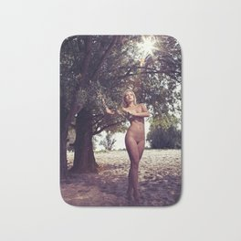 Beautiful Nude woman standing under a tree Bath Mat