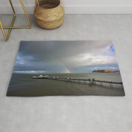 Rainbow at sea, Llandudno pier, Wales, UK Rug