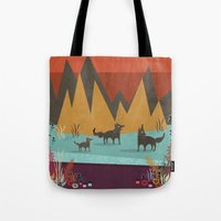 wolves Tote Bags featuring Wolves by Kakel