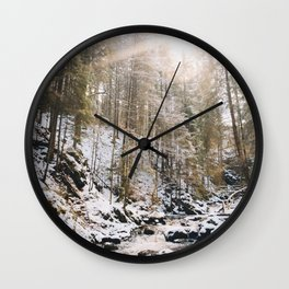 a river, a sun and a bit of snow Wall Clock