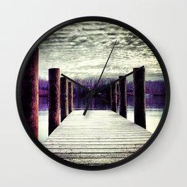 Moody winter skies on the lake Wall Clock