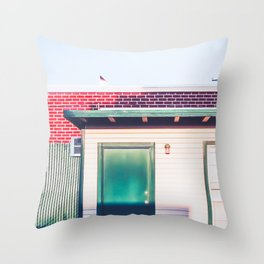 green wood building with brick building in the city Throw Pillow