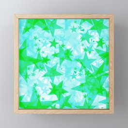 Bright green iridescent stars on a light background in the projection. Framed Mini Art Print