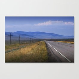 Montana Roadway running through the  Mountain Foothills Canvas Print