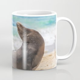 Sea lion sunbathing on beach Coffee Mug