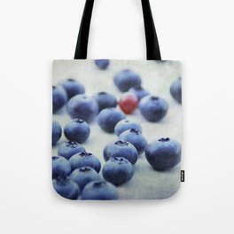 Blue berries with one red currant Tote Bag