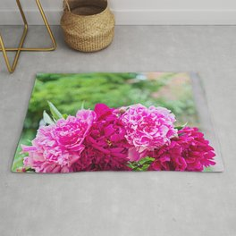 Fresh pink peony flowers bouquet on the table. Shallow depth of field. Rug