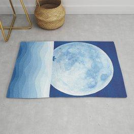 Full moon & paper boat Rug
