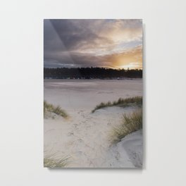 Sunset, beach huts and footprints in the sand. Norfolk, UK. Metal Print