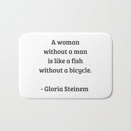Gloria Steinem Feminist Quotes - A woman without a man is like a fish without a bicycle Bath Mat