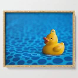 Small plastic duck on a blue gift paper Serving Tray