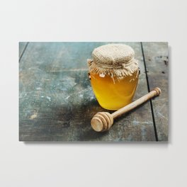 Honey jar and dipper on wooden background Metal Print