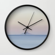 Island silhouette on horizon at sunset Wall Clock