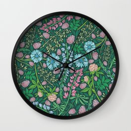 Violet clover and lupine among cornflowers and herbs Wall Clock