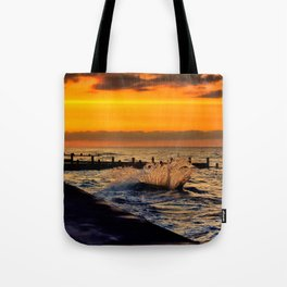 Ocean sunset at walcott Tote Bag