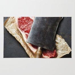 vintage cleaver and raw beef steak on dark background Rug