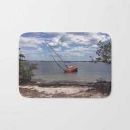 Red Sailboat Aground Bath Mat