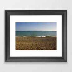 Evening Tide on a cobbled beach Framed Art Print