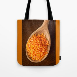 Healthy food red lentils on wooden spoon Tote Bag