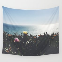 cactus flowers in front of the ocean Wall Tapestry